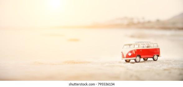 Tel Aviv, Israel - April 10, 2017: Miniature VW Bulli 1962 on the beach in soft focus.