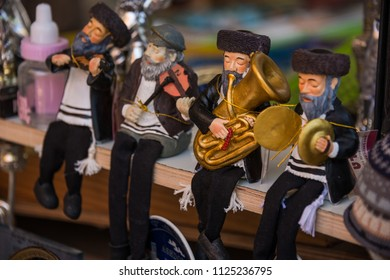 Tel Aviv, Israel - april 30, 2015: Selective focus of figures representing Jewish musicians, at a souvenir stand in the Carmel market, in the city's commercial center