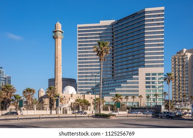 Tel Aviv, Israel - april 30, 2015: Minaret of the Hassan Bek Mosque and modern building on the maritime avenue of the city
