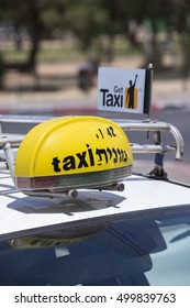TEL AVIV, ISRAEL - APRIL 30, 2015: Neon sign on the roof of a taxi in the city