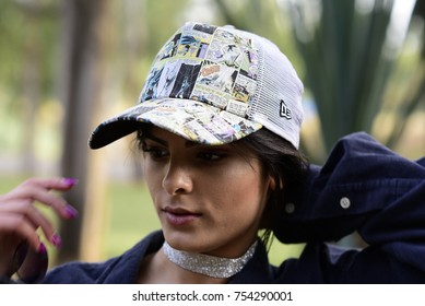 """TEL AVIV, ISRAEL - April 30 2017: A girl wearing a New Era comic-themed cap (with comics art from Batman issue #181 """"Beware of -- """"Beware of -- Poison Ivy!""""!"""")"""