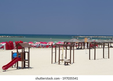 TEL AVIV, ISRAEL - AUGUST 2, 2012: High angle view of the beach in Tel-Aviv, second most popular city in Israel, packed with tourists from all over the world on a hot summer day, in Tel Aviv, Israel