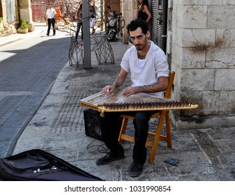 Tel Aviv, Israel, August 2017, ayoung man playing on ''qanun'' , traditional string instrument on oriental bazaar or suk market