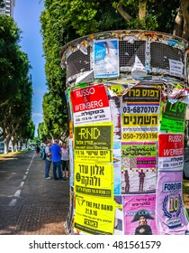 TEL AVIV, ISRAEL - AUGUST 24, 2016 : Street  advertising  column on Boulevard Rothschild in Tel Aviv, Israel.  Boulevard Rothschild is the most prestige street  in Tel Aviv.