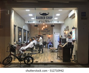 TEL AVIV, ISRAEL - AUGUST 24, 2016 : Hair beard and mustache treatment in stylish barber shop, Tel Aviv, Israel. View through the window