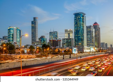 TEL AVIV, ISRAEL - DECEMBER 04, 2016 : Sunset view of Ayalon highway over Ramat Gun skyscrapers in Tel Aviv , Israel. View from the bridge above Ayalon highway.