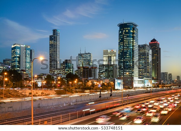 TEL AVIV, ISRAEL - DECEMBER 08, 2016 : Sunset view of Ayalon highway over Ramat Gun skyscrapers in  Tel Aviv, Israel. View from the bridge above Ayalon highway.