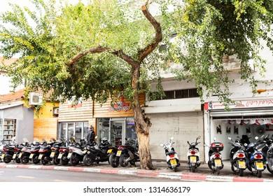 Tel Aviv, Israel - December 28, 2018: A motorbikes parked in row in front of motorcycle shop in Tel Aviv, Israel