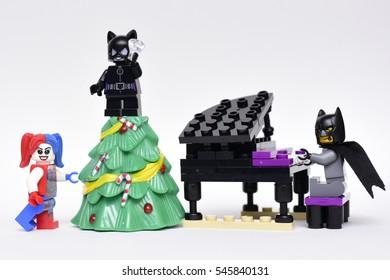 Tel Aviv, Israel- December, 31, 2016: Batman, Harley Quinn and Catwoman Lego minifigures celebrating a festive Christmas together
