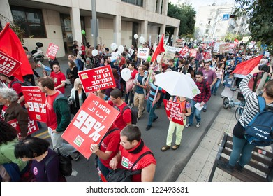 TEL AVIV, ISRAEL - DECEMBER 7: Members of the leftist Israeli political party Hadash march in red during the annual human rights march in Tel Aviv, Israel, December 7, 2012.