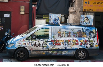 """TEL AVIV, ISRAEL - FEBRUARY 18, 2014: A car of Nachman of Breslov hasidic movement with colorful graffiti and a message (in Hebrew) """"It is a great mitzvah (commandment) to be happy always""""."""