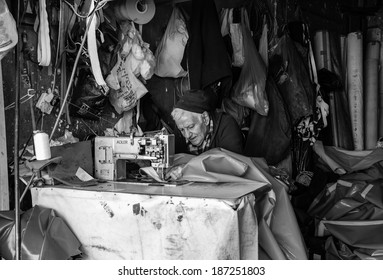TEL AVIV, ISRAEL - FEBRUARY 18, 2014: An unidentified senior man in the small workshop is occupying in the tailoring of the large plastic bags for packing industry.