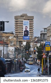 TEL AVIV, ISRAEL - FEBRUARY 28, 2019: Elections sign of the Likud party at Jabotinsky Institute building in Tel Aviv. Television personality Eliraz Sade is used to advertise the likud party.