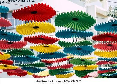 Tel Aviv Israel July 16, 2019 View of Colorful parasols at the carmel market in Tel Aviv
