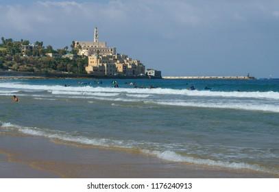 TEL AVIV, ISRAEL - JULY 17, 2018: Beach in Charles Clore Park  on background of Jaffa, Old City (Tel Aviv-Yafo)