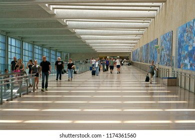 TEL AVIV, ISRAEL - JULY 18, 2018: Ben Gurion Airport. Passengers with suitcases in airport