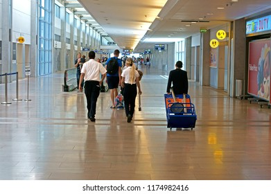TEL AVIV, ISRAEL - JULY 18, 2018: Ben Gurion Airport. Passengers with suitcases and luggage in airport.