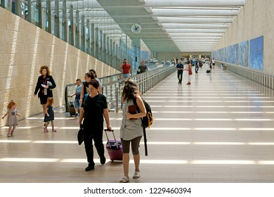 TEL AVIV, ISRAEL - JULY 18, 2018: Ben Gurion Airport. Passengers with baggage in summer. Transition from one terminal to another