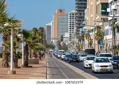 TEL AVIV, ISRAEL - JULY 19, 2017: View of traffic flow along modern hotel buildings and promenade in Tel Aviv - second most populous city in Israel, popular tourist destination and business center.