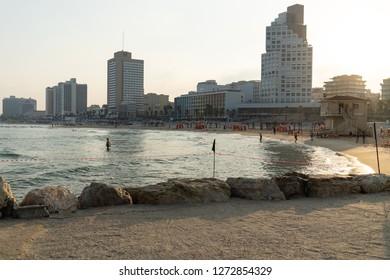 Tel Aviv, Israel - July 4, 2018: Swimming in the beautiful Mediterranean Sea while vacationing in Tel Aviv, Israel.