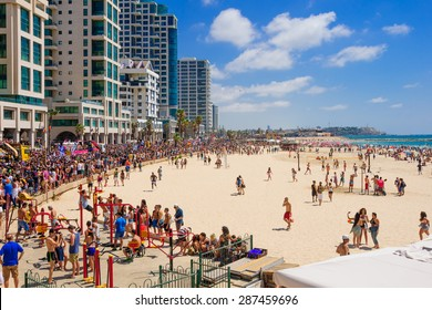 TEL AVIV, ISRAEL - JUNE 12, 2015: View of the beach of Tel-Aviv, the old city of Jaffa and the crowd Pride Parade participants in Tel-Aviv, Israel. Its part of an annual event of the LGBT community