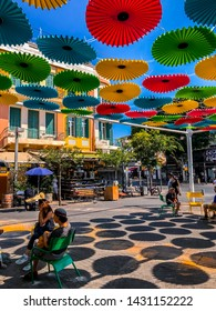Tel Aviv, Israel - June 16, 2019: Buildings and people at Magen David Square on Allenby Street next to the Carmel Market, Tel Aviv.