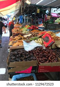 TEL AVIV, ISRAEL - JUNE 24, 2018: Carmel Market, the largest market, or shuk, in Tel Aviv, where traders sell everything from clothing to spices, and fruit to electronics.