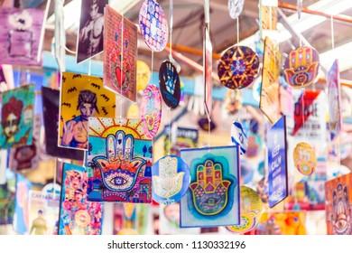 Tel Aviv, Israel - June 8, 2018: Decorative hamsa souvenirs sold at Carmel Market, Tel Aviv, Israel.