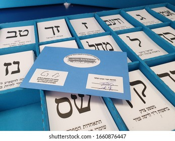TEL AVIV, ISRAEL. March 2, 2020. Voting ballot envelope over a blue box with white ballots at the 23 Knesset parliamentary elections in Israel. Israel democracy concept image.