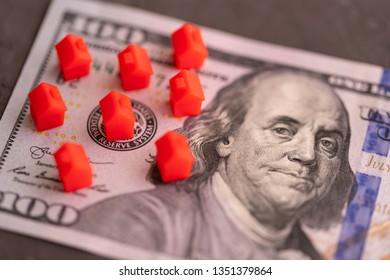 Tel Aviv, Israel. March 21, 2019. Red mini houses on dollar banknote. Prices on real estate concept.
