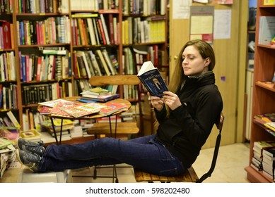 Tel Aviv, Israel- March, 5, 2017: A woman reads Lev Grossman's 'The Magicians,' at a book store