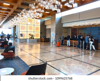 TEL AVIV, ISRAEL - MAY 15, 2018: Guests at the Hilton Hotel Lobby Desk. Situated in Independence Park, the Hilton Tel Aviv offers easy access to the Mediterranean Sea.