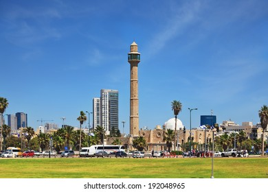 TEL AVIV, ISRAEL - MAY 2, 2014:  Arab mosque and minaret on the background of high-rise hotel. Spring Tel Aviv promenade