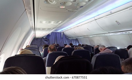 Tel Aviv, Israel - May 20, 2017: Passengers in airplane aircraft jet seats. Flying in economy and business class airliner cabin.