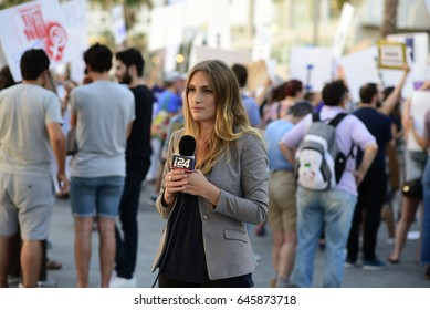 Tel Aviv, Israel- May 22, 2017: Reporter of i24 news covering a protest against Donald Trump In front of the US Embassy in Tel Aviv