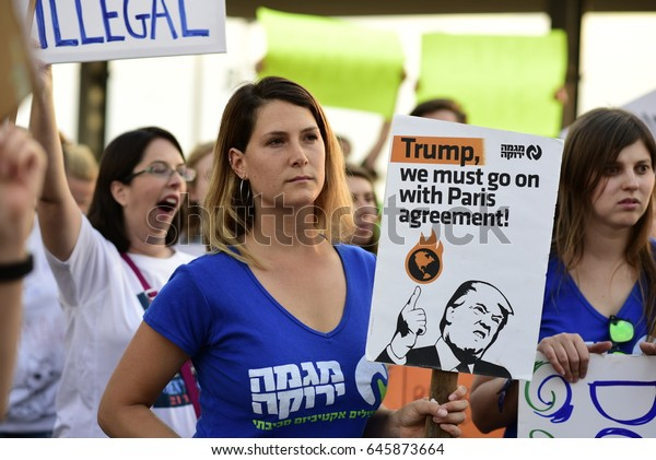 Tel Aviv, Israel- May 22, 2017: Democrats and Israeli environmental activists protest against Donald Trump In front of the US Embassy in Tel Aviv