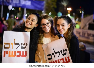 "TEL AVIV, ISRAEL - November 04 2017: Israeli girls holding signs that read ""Peace Now"" during a memorial rally to former prime minister of Israel Yitzhak Rabin"