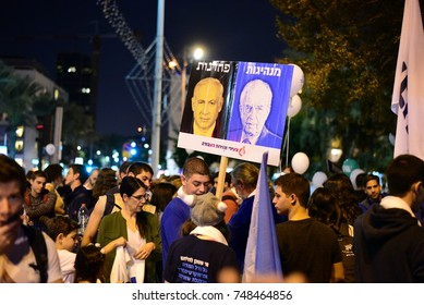 "TEL AVIV, ISRAEL - November 04 2017: Israeli hold a sign that reads (from right to left) ""Leadership ; Cowardness"" during a memorial rally to former prime minister of Israel Yitzhak Rabin"