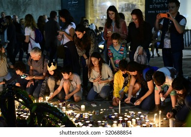 TEL AVIV, ISRAEL - November 06 2016: Israelis light candles at the site of prime minister Yitzhak Rabin murder during a rally marking 21 years since the assassination of Yitzhak Rabin at Rabin Square