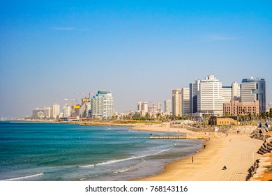 TEL AVIV ISRAEL November 2016: Tel Aviv beach coast with a view of Mediterranean sea and skyscrapers.