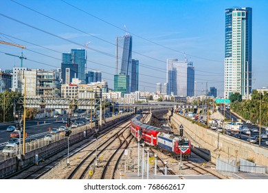 TEL AVIV, ISRAEL - November, 2016: View to the railway station and red train over new skyscrapers in Tel Aviv.