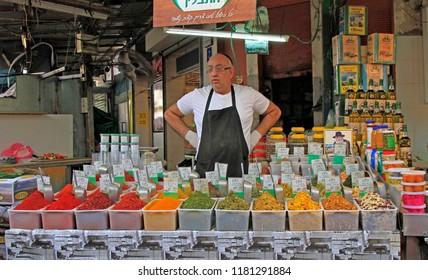 Tel Aviv, Israel - November 30, 2017: man sells seasonings at Carmel market in Tel-Aviv, Israel
