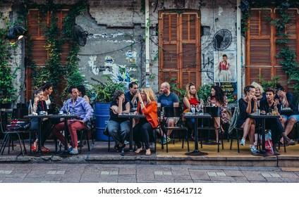 Tel Aviv, Israel - October 20, 2015. People sits at tables outside the restaurant at Rothschild Boulevard in Tel Aviv