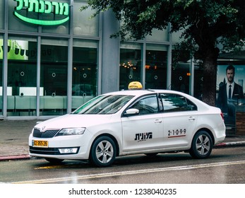 Tel Aviv Israel October 23, 2018  View of a traditional Israeli white taxi rolling in the street of Tel Aviv in the afternoon