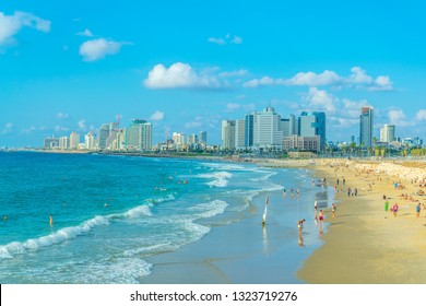 TEL AVIV, ISRAEL, SEPTEMBER 9, 2018: People are enjoying a sunny day on a beach in Tel Aviv, Israel