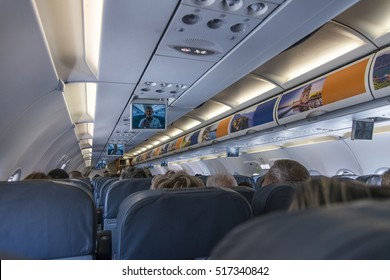 Tel Aviv, Israel-19 September, 2016 : The interior of the aircraft and passengers on seats in Ben-Gurion airport in Tel Aviv, Israel