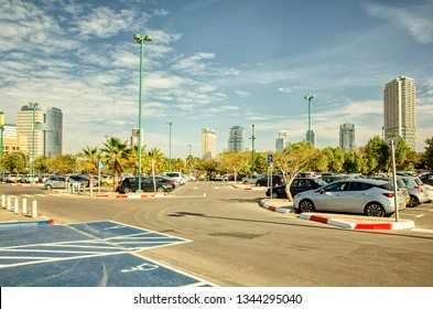Tel Aviv, Israel-December 10, 2017: A public car parking in the south of the city seafront provides parking for as for office staff of the nearest office building as well as for tourists.