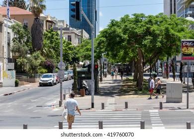 TEL AVIV,  ISRAEL-JUNE 13, 2015:famed Rothschild Boulevard. People walk down the avenue