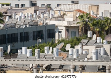 TEL AVIV - JAFFA, ISRAEL. September 9, 2016. Jaffa roof tops with water tanks on the top of houses. Solar water heaters.