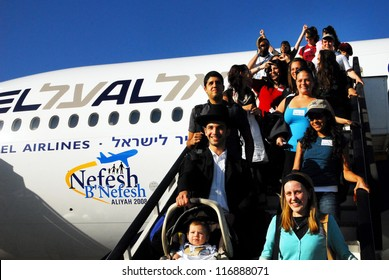 TEL AVIV - JULY 22: New Jewish immigrants making Aliya in Ben Gurion Airport on July 22 2008.It's the immigration of Jews to the Land of Israel since the Babylonian exile.